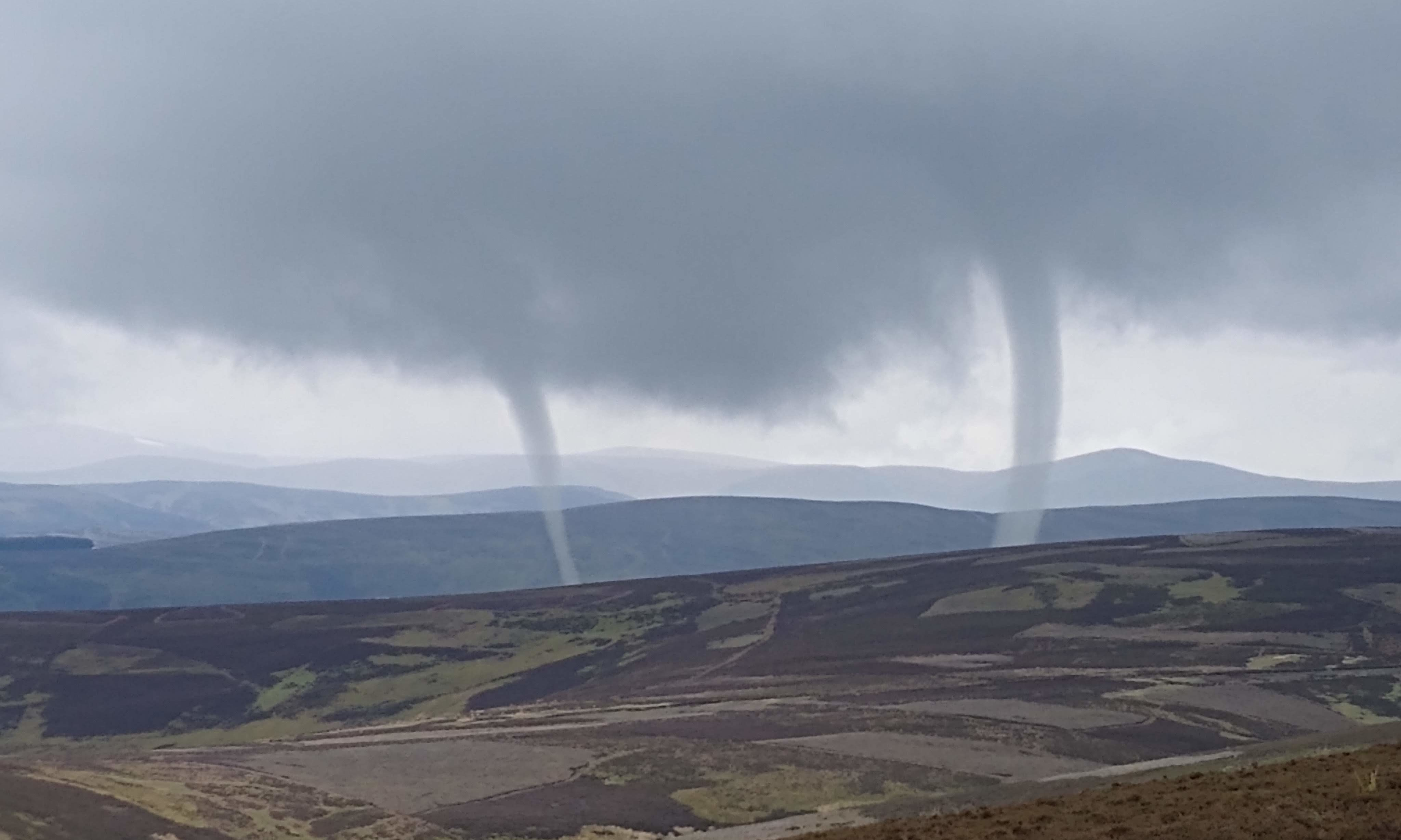 Dave Barrett captured the rare double tornado  in the hills north of Kirriemuir in May.