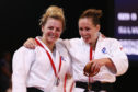 Stephanie Inglis and Connie Ramsay of Scotland pose with their medals on day one of the Glasgow 2014 Commonwealth Games.