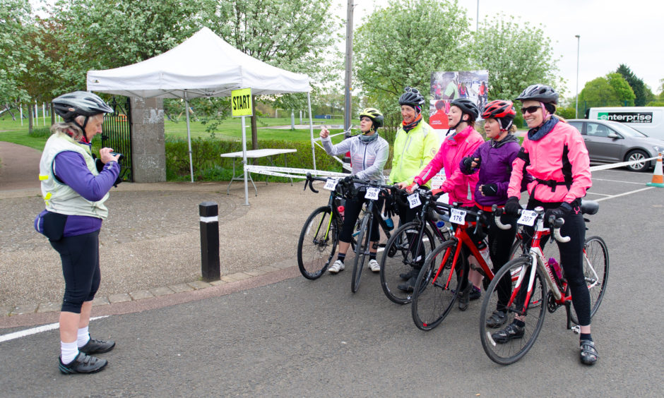A group of cyclists eager to get started.