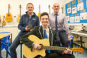 Pupil Adam Elder, 15, won first annual prize at Monifieth High SchooPaul Smith, Adam and music teacher, Stuart Brand