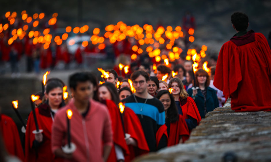 The annual Gaudie pier walk took place in St Andrews to commemorate the selfless actions of one of one of the town's greatest figures John Honey who saved five fishermen. The spectacular torchlight procession sees students in their red gown walk along the historic pier.