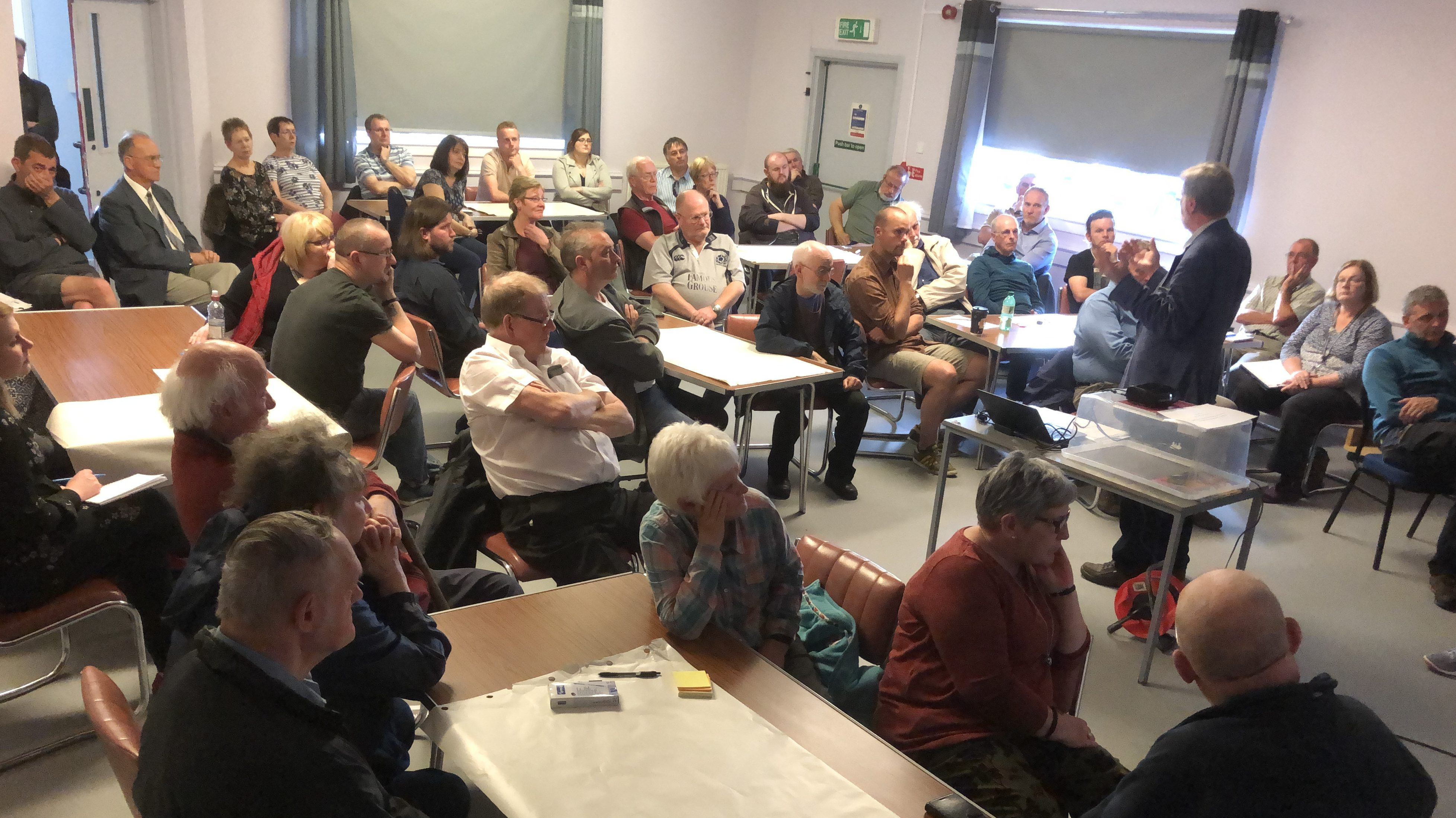 Rail consultant David Prescott addresses a packed public meeting in Kincardine