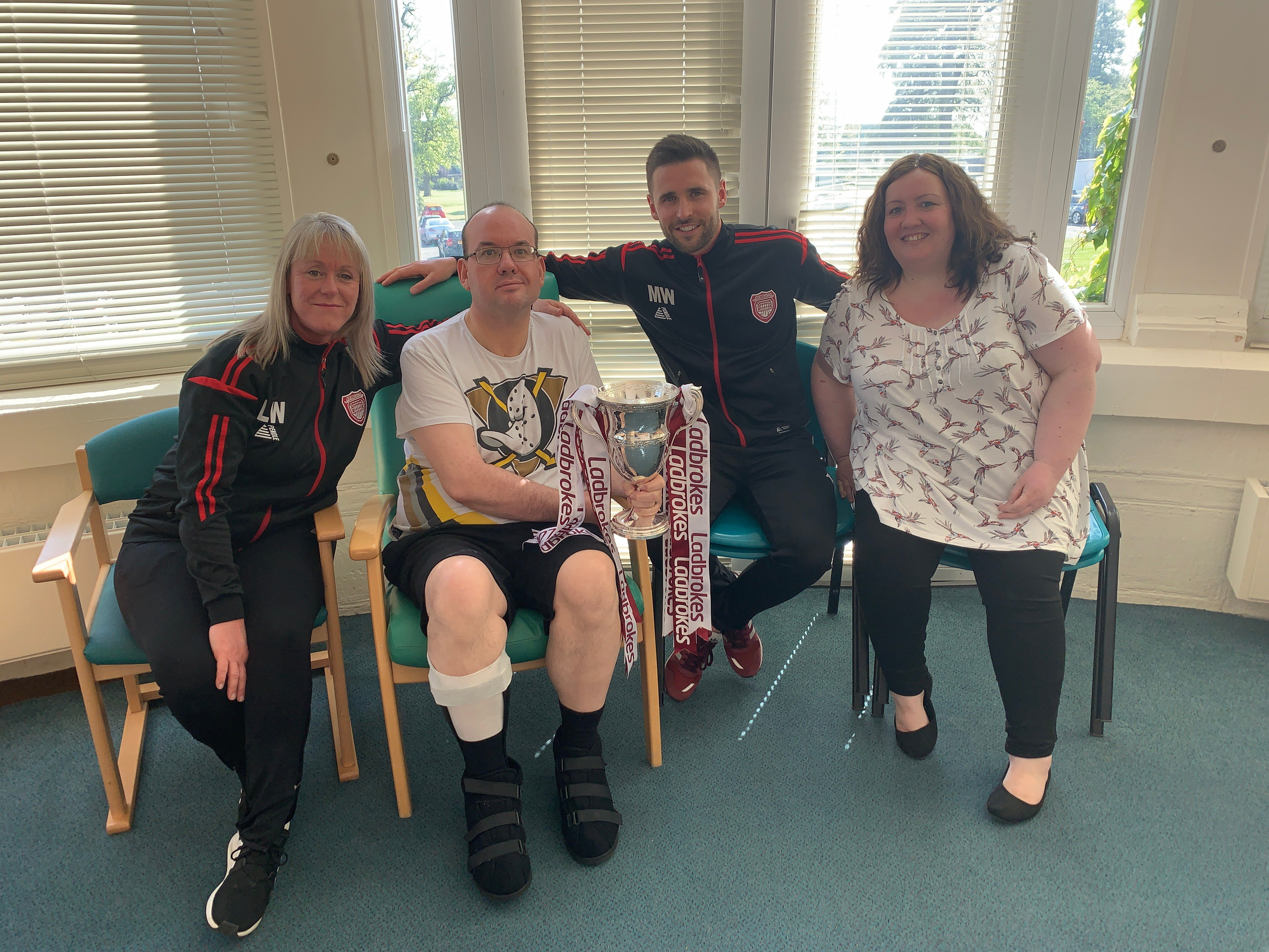 Neil and wife Natasha with club captain Mark Whatley and Lichties operations and kit manager Louise Walker