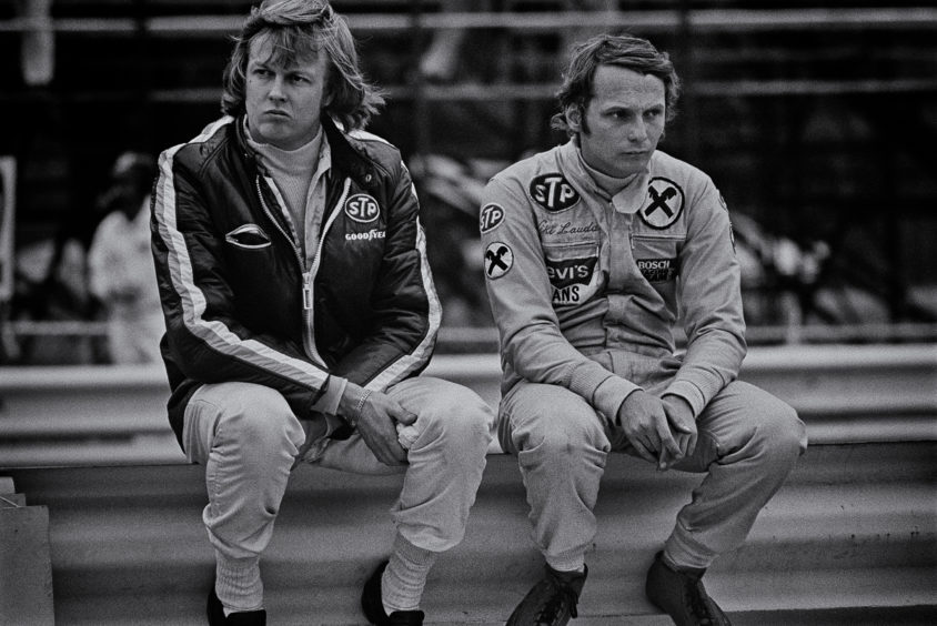 For Ronnie Peterson and teammate Niki Lauda, it's all gloom as they consider their options for the coming season during the 1972 United States Grand Prix. Driving for STP-March F1 had been a nightmare, as they both hopped from March 721 to March 721X to March 721G in the hope of finding a reliable car with speed. Peterson, seen as having the potential to be a future World Champion was the luckier, scoring a fourth place in the US. Lauda was in dire trouble, with no points for the season. He had taken out a loan to pay for his seat at March, and was desperate to find results and monetary return. Peterson would stay at March one more year, and then join Lotus for 1974 where he would win four Grands Prix and finish 3rd in the World Championship. He would finish 2nd in the 1978 World Championship posthumously. Lauda would move to Marlboro-BRM in 1974 and then to Scuderia Ferrari, where he would win the 1975 and 1977 World Championships. He would add a third with McLaren in 1984.