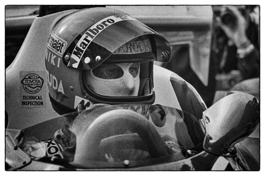 Niki Lauda waits quietly before the start of the 1977 US Grand Prix at Watkins Glen. He will finish fourth in the rain to lock in his second World Drivers Championship