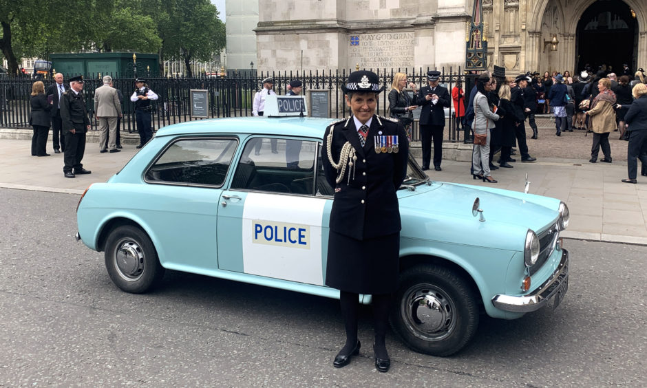 Metropolitan Police Comimssioner Cressida Dick stands with a vintage police car before going into Westminster Abbey for a special service on Friday, marking 100 years of women police officers in the Met.