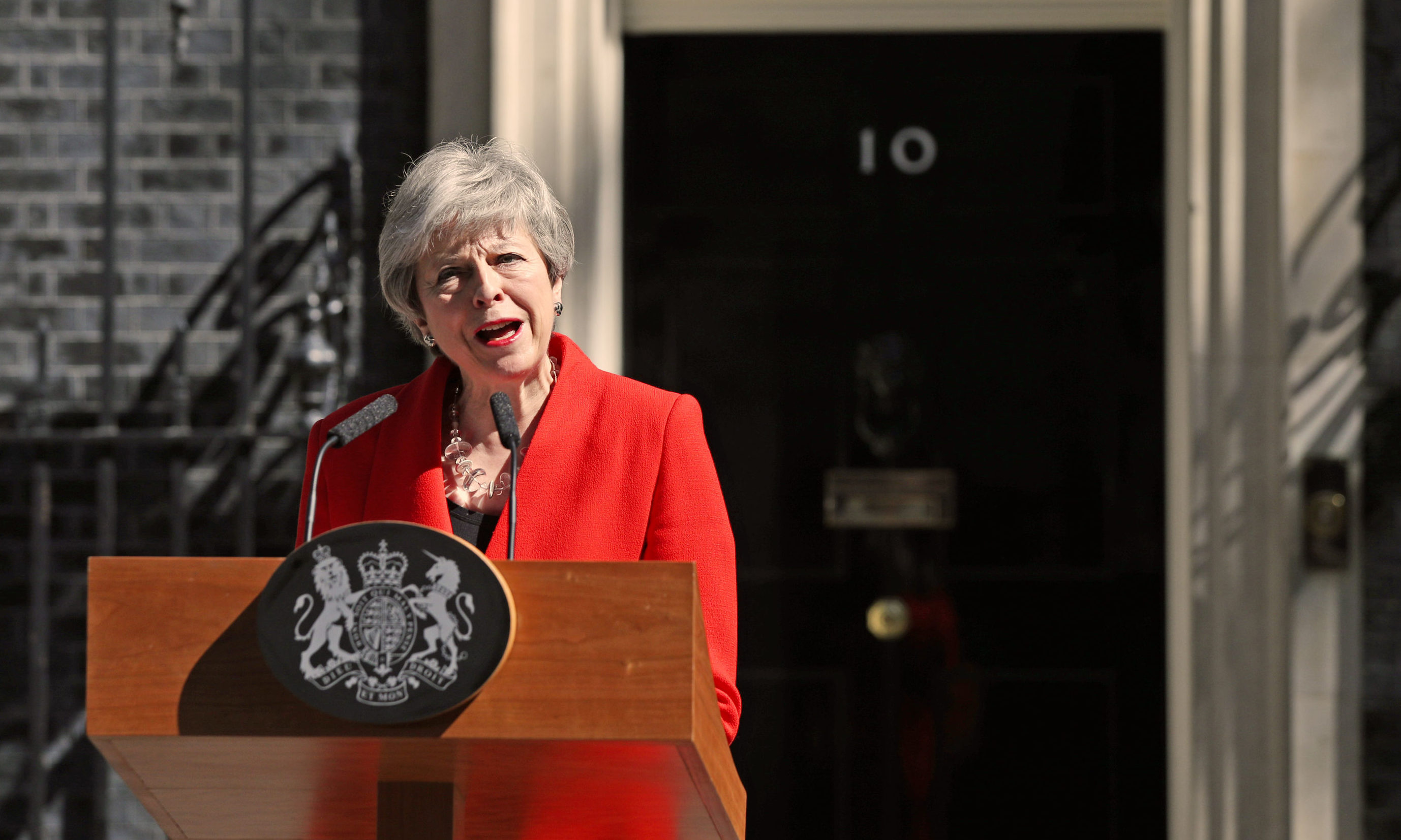 Prime Minister Theresa May makes a statement outside at 10 Downing Street.