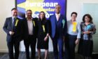 Newly elected MEPs L-r Alyn Smith, Christian Allard, Aileen McLeod, Louis Stedman-Bryce, Sheila Ritchie and Nosheena Mobarik at the European Parliamentary elections count at the City Chambers in Edinburgh.