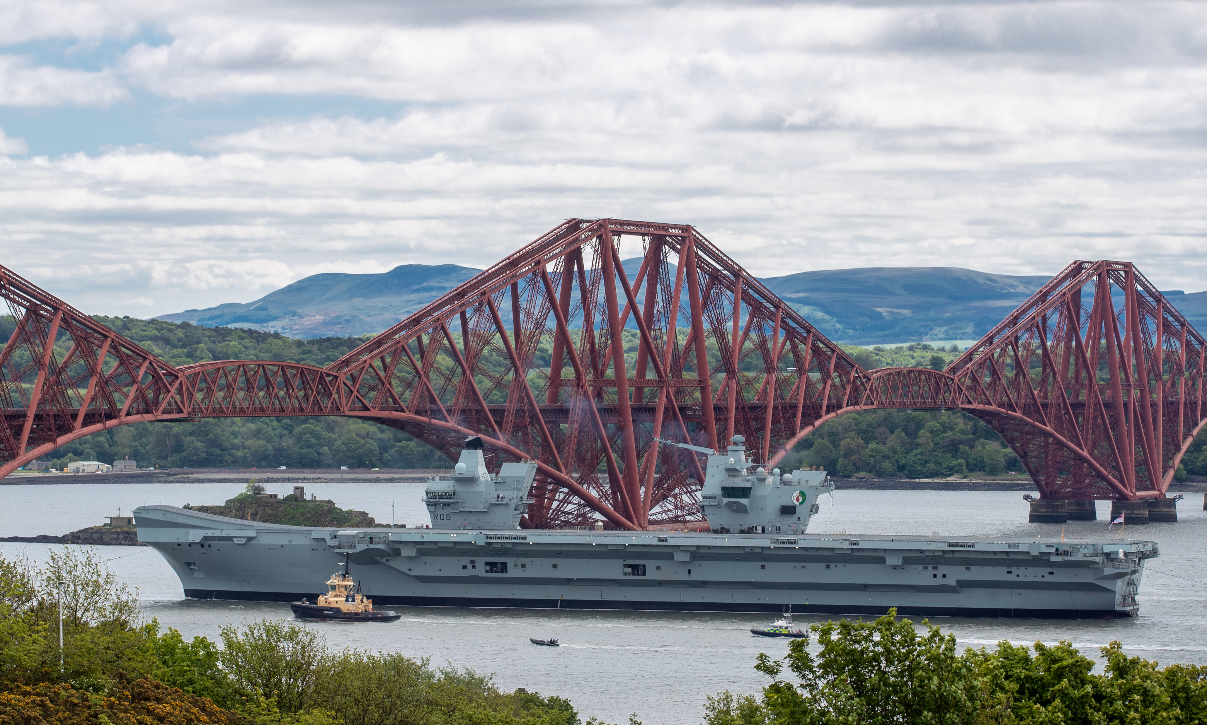 The HMS Queen Elizabeth sails under the Forth Bridges as she heads south from Rosyth, where she was built.