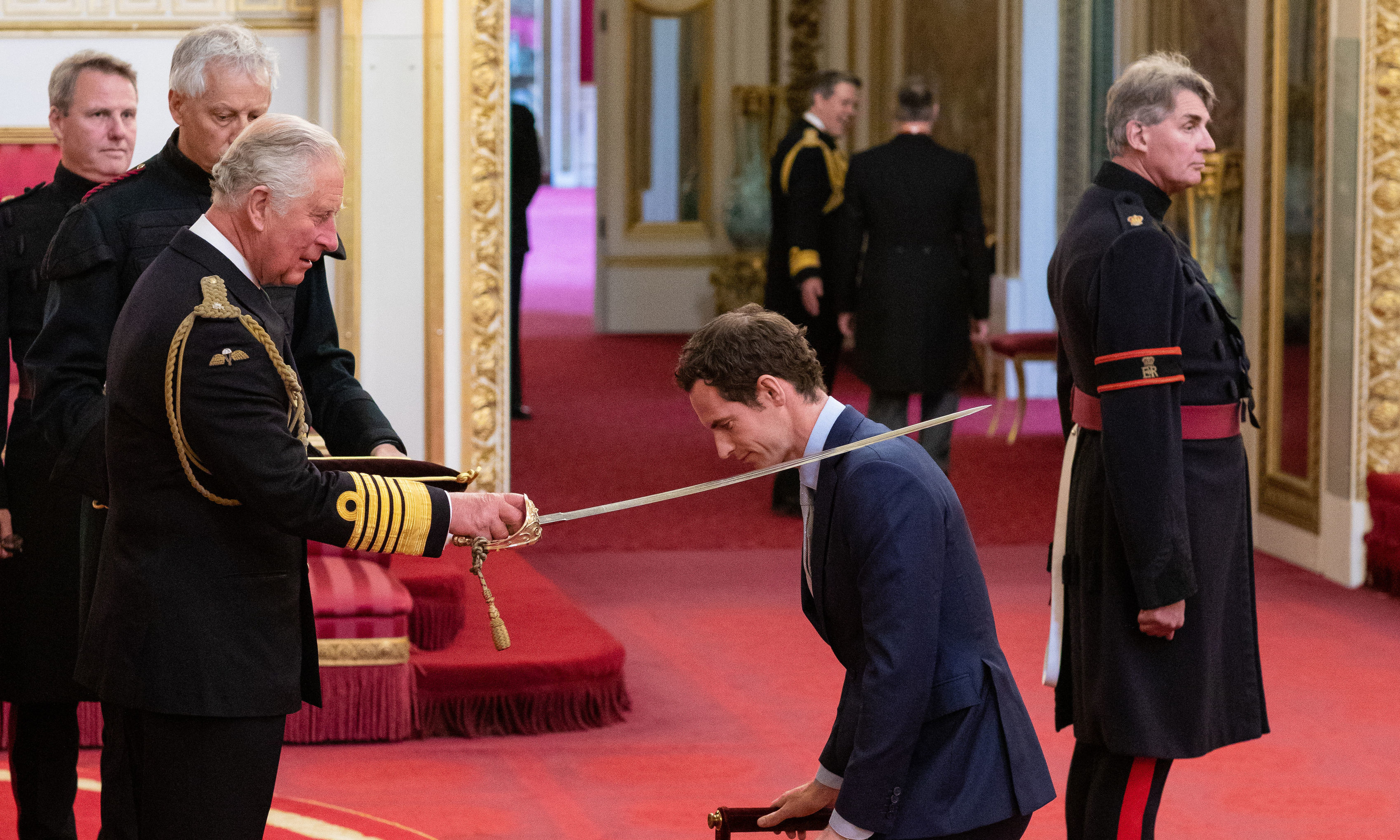 Andy Murray receives his knighthood from the Prince of Wales.