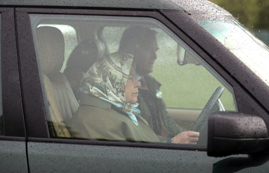 Queen Elizabeth II at the Royal Windsor Horse Show in Windsor, Berkshire. Still driving at 93.