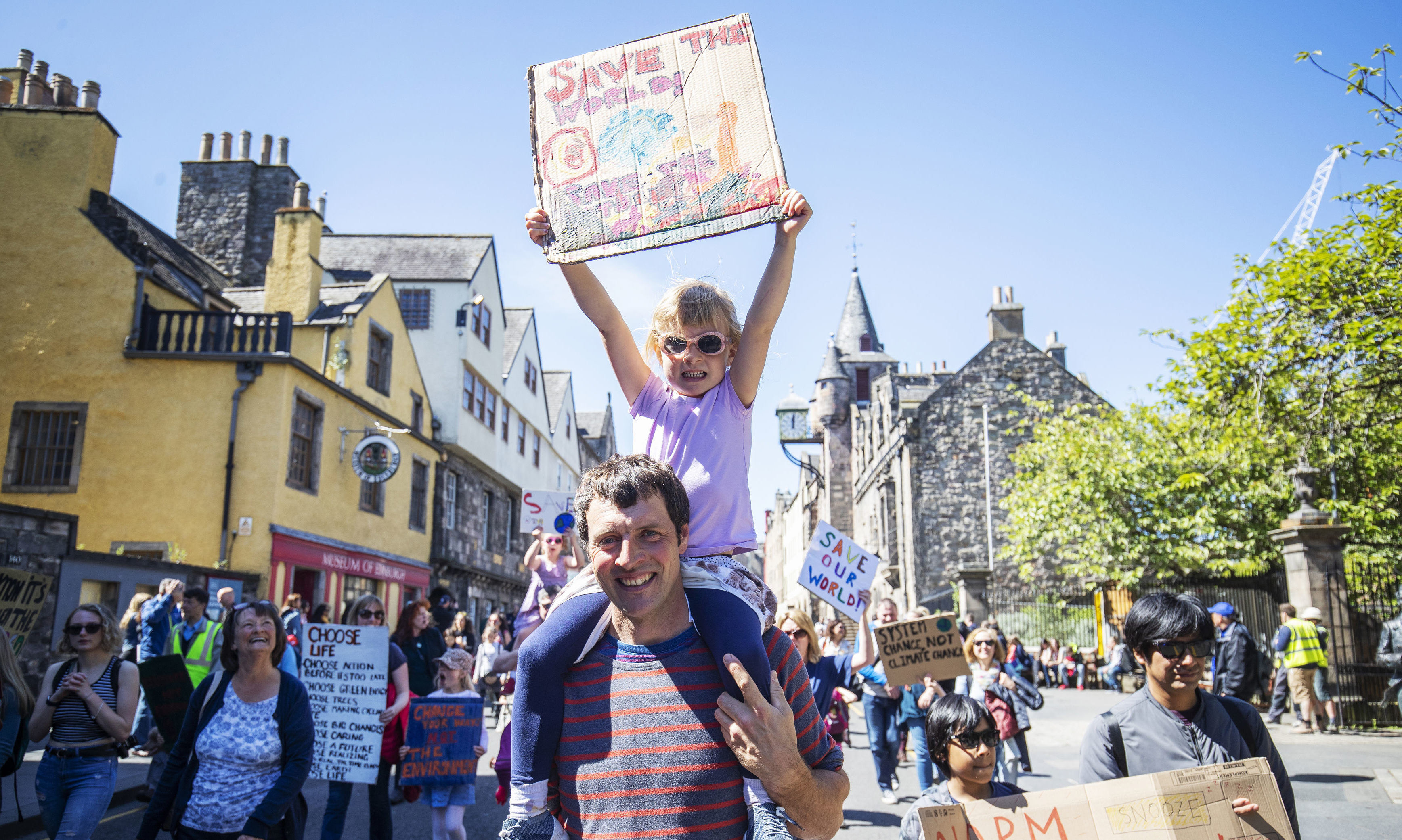 Alan Blackburn with his daughter Hanna Blackburn, five, join thousands of school children and students taking part in the Scottish Youth Climate Strike, in Holyrood to demand urgent action to tackle climate change.