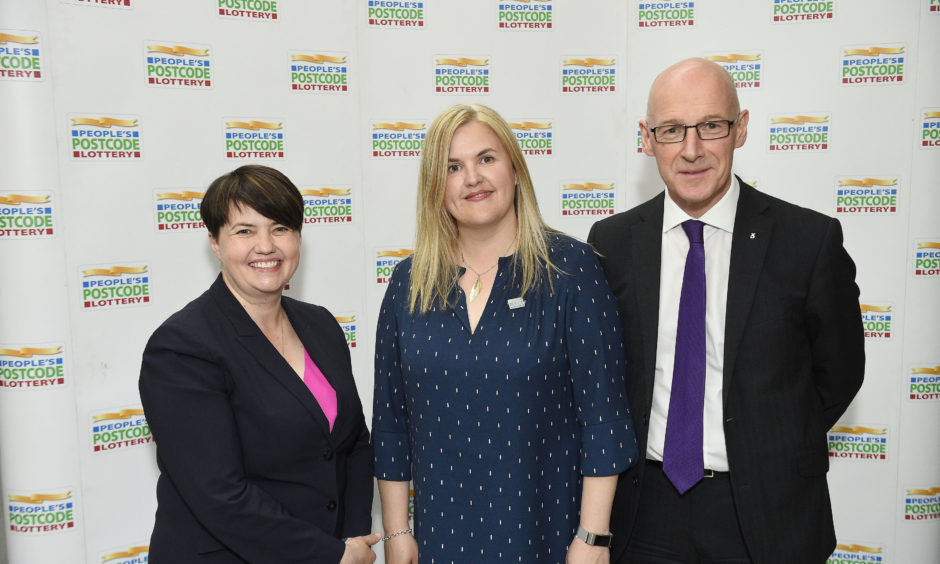 """Scottish Conservative leader Ruth Davidson, Managing Director of People's Postcode Lottery Clara Govier and Education Secretary John Swinney at the People's Postcode Lottery launch of """"Small Change: How charity lottery limits impact on small charities"""" at The Scottish Parliament. Among the topics discussed was raising the current limit from £10 million to £100 million – which could help generate more money for good causes across the country."""