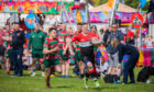 Glasgow Hawks (red and white) vs Dalkeith RFC (green and red).