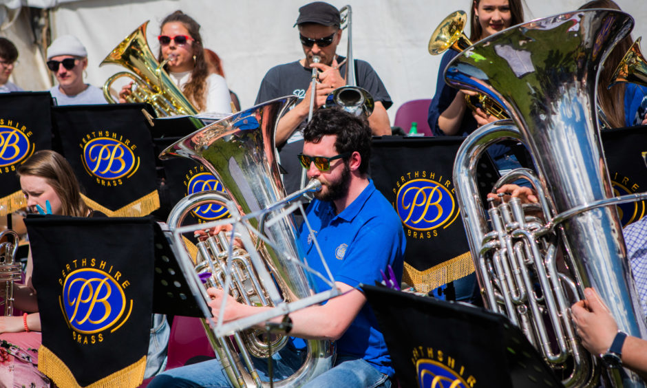 Perthshire Brass peform in the sun outside the beer festival marquee.