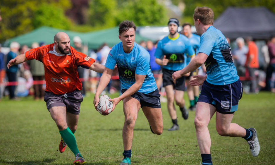 Action from the rugby tournament;  LFEA RFC (from Edinburgh, light blue) vs Montrose Rugby team (orange/red).