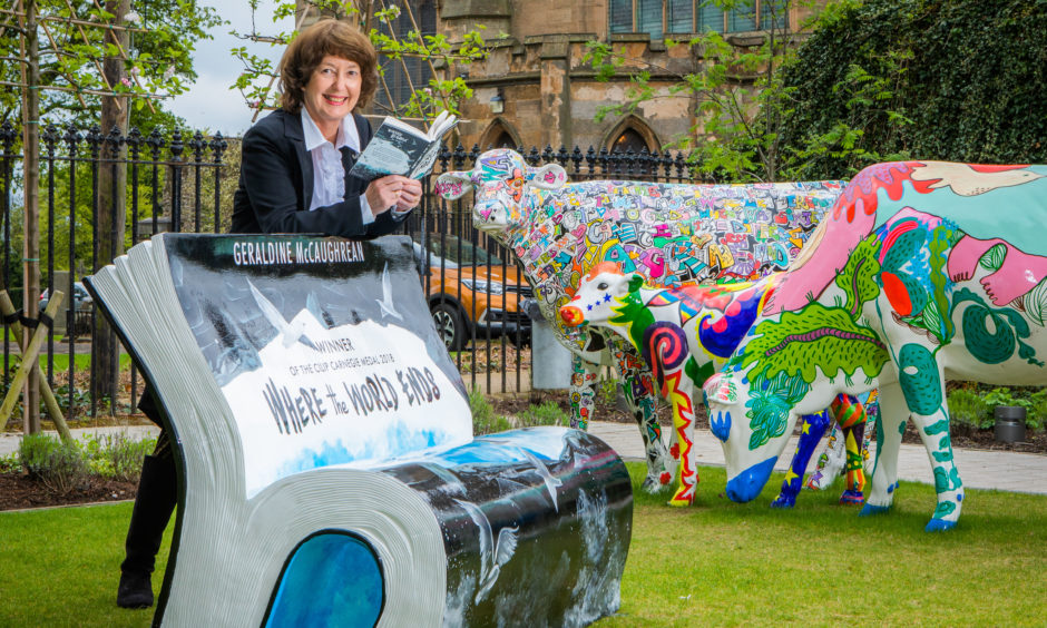 Geraldine McCaughrean, winner of the Carnegie Medal launched the Carnegie 100 at the world's first Carnegie Library by unveiling a specially designed bench/ The bench commemorates her book based on the true story of boys marooned on St Kilda.