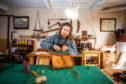 Hamish Lamley in his workshop working on a bag.
