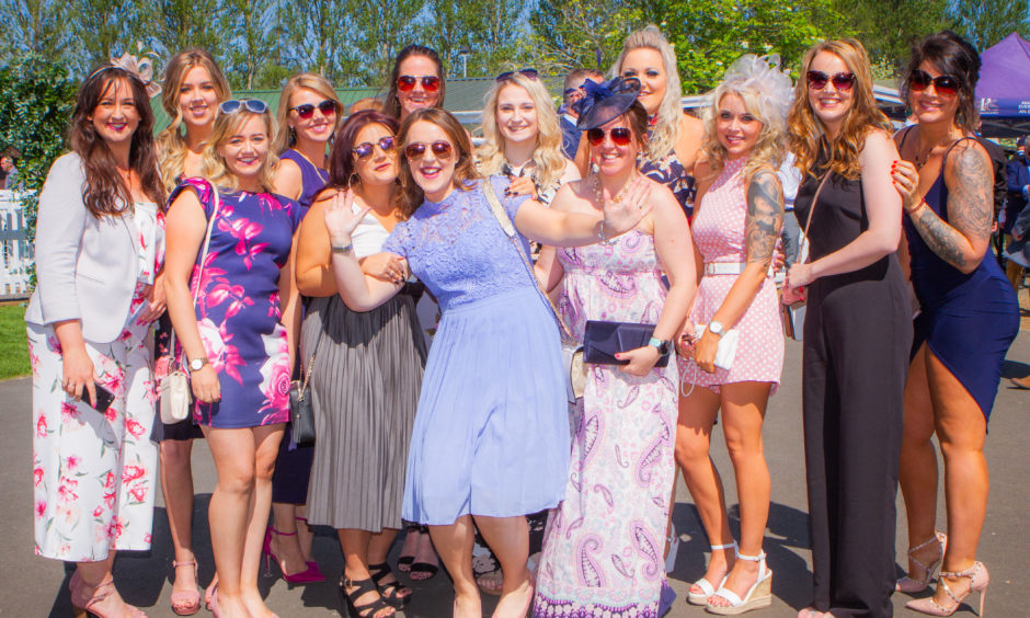 Jennifer Beveridge celebrates her 30th birthday at the races along with her family and friends.