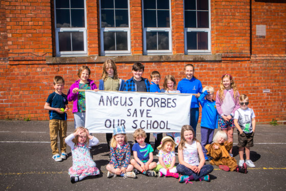 The community in Abernyte are pleading for Angus Forbes' vote.