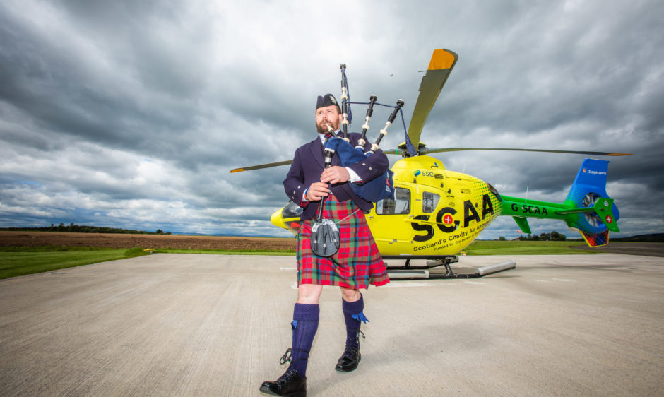 A Pitlochry piper has unveiled a toe-tapping march in honour of the work carried out by Scotland's Charity Air Ambulance (SCAA) paramedics. Ross McNaughton, piping instructor at the Robert Gordon College in Aberdeen, penned Angels Of The Glens in tribute to the crew of Scotland's only charity-funded helicopter air ambulance service. The 40-year-old from Pitlochry has been piping since he was six years old. He is pipe major with the Vale of Atholl  Grade Four Development Pipe Band, and a piper with The Atholl Highlanders.