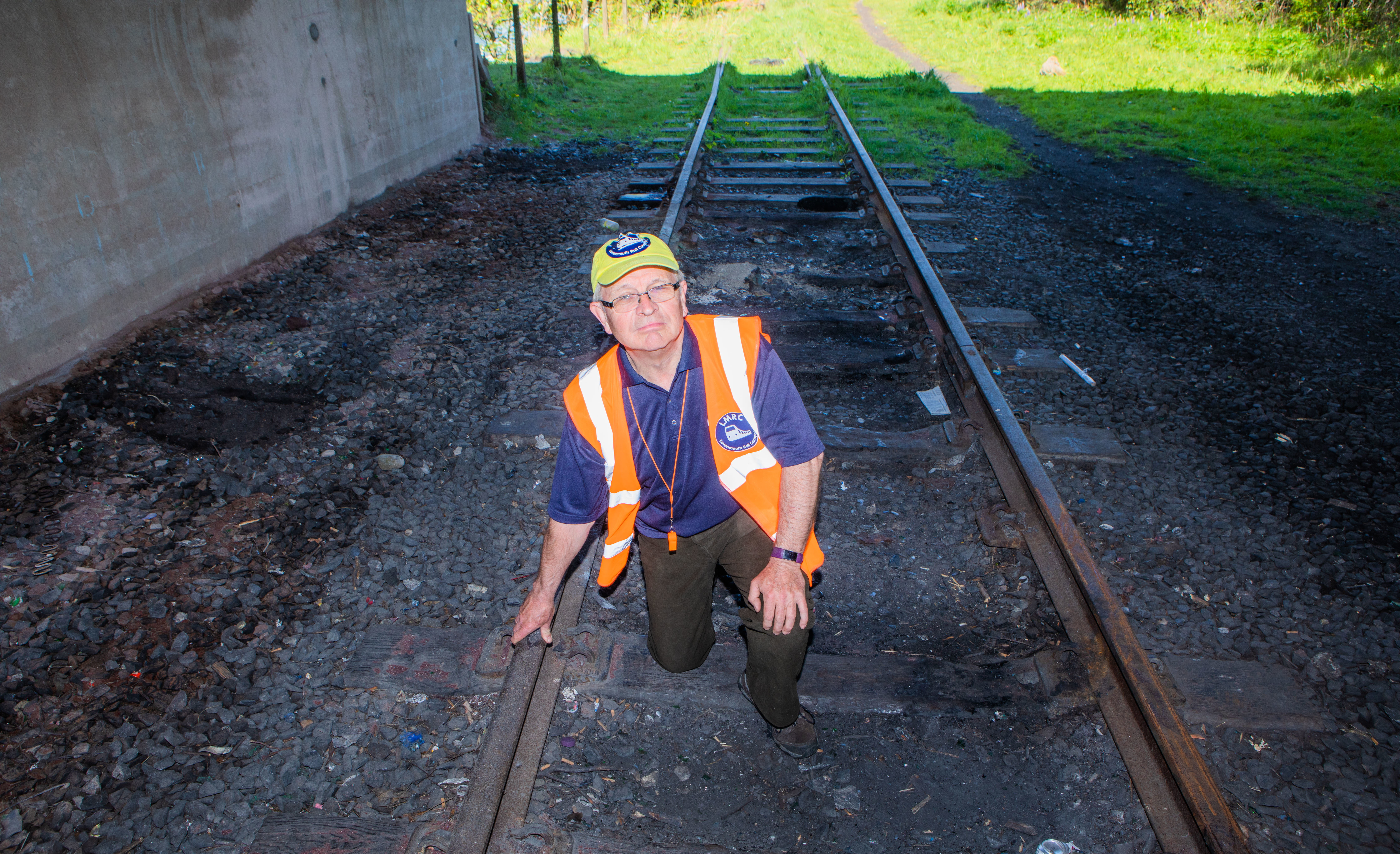 Rail campaign secretary Allen Armstrong examining the old railway line