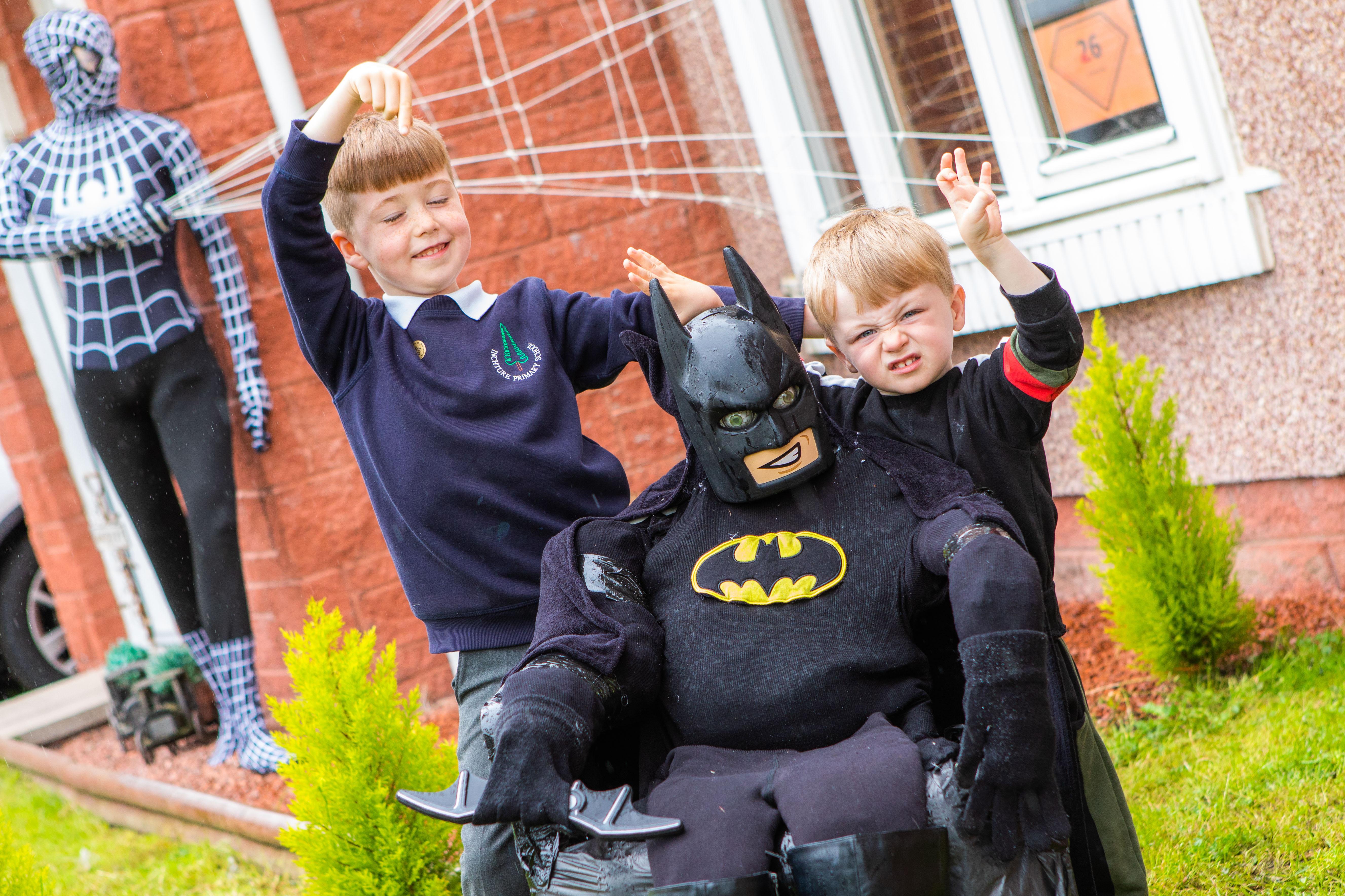 Rio Callazi, 7, and brother Chase, 2, with Batman.