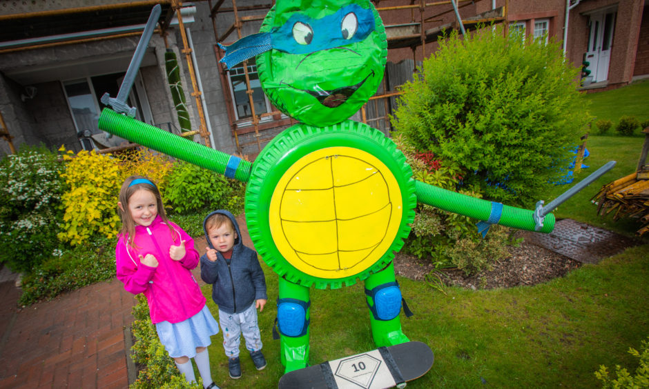 A league of superheroes has assembled in a Perthshire village. Residents in Inchture have welcomed a host of colourful characters into their front gardens, as excitement builds for the village's comic book-themed summer gala. Families are invited to follow a trail around the area to search for well-known faces like Batman, Superman, Spider-man and Iron Man. Maps for the village's first Superhero Challenge are on sale at the Olly Bobbins florist and gift shop, with all proceeds going towards gala funds.