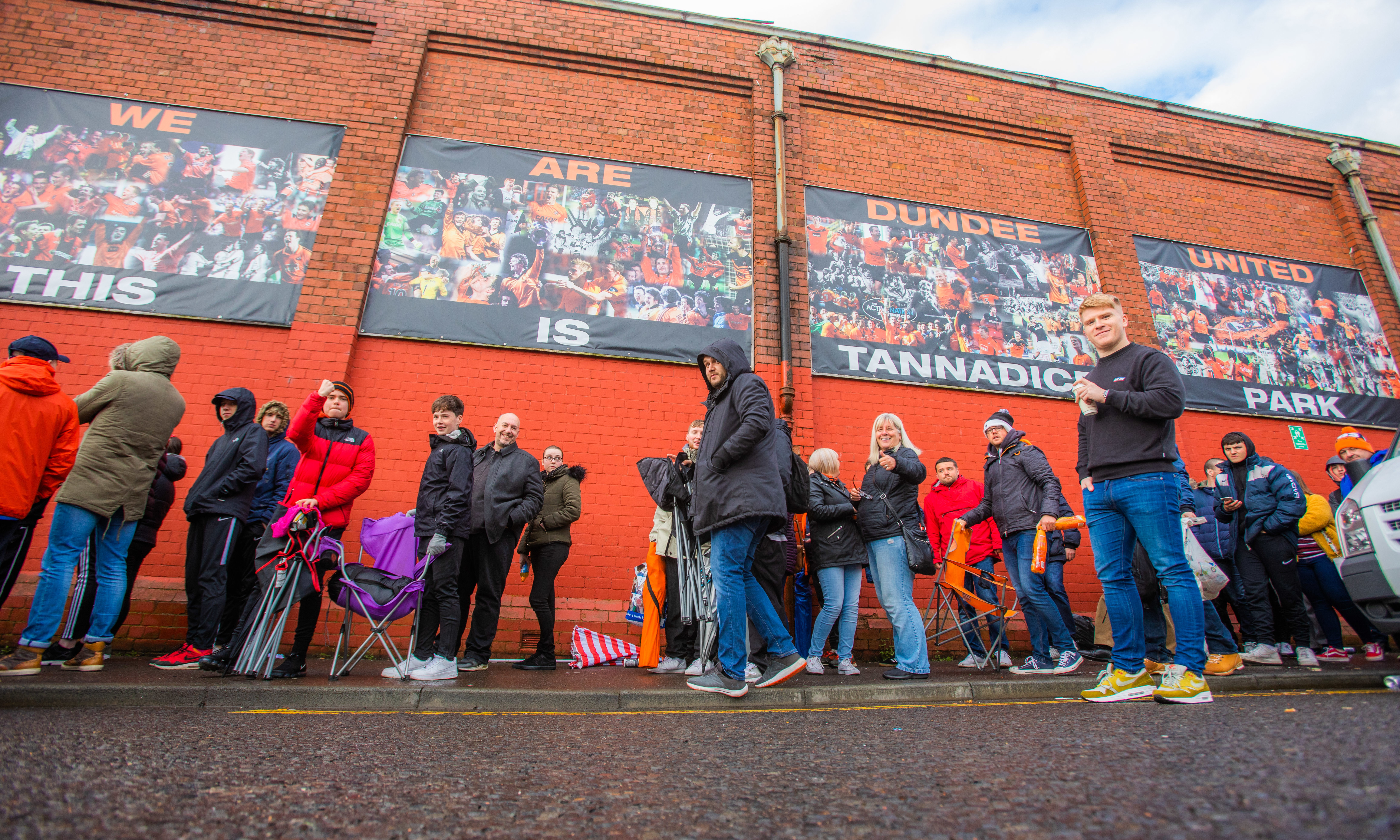Dundee United fans queuing for play-off final tickets.