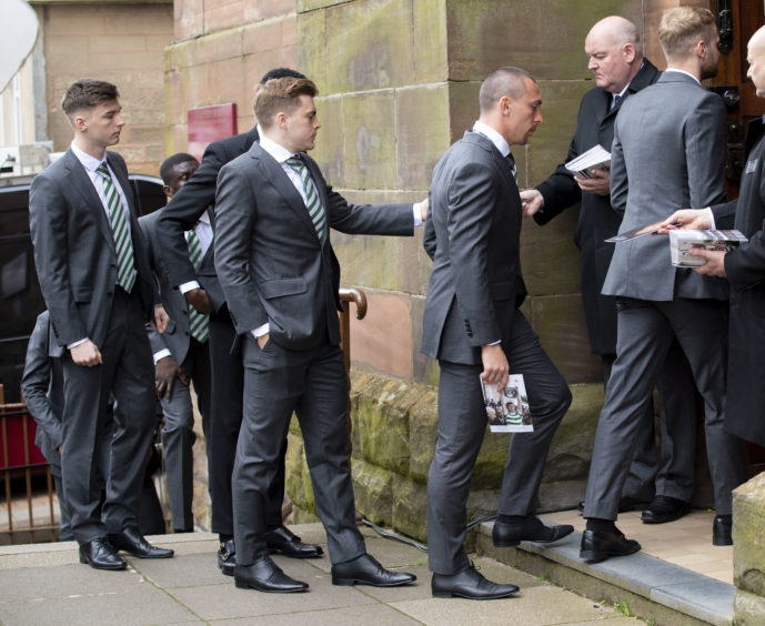 03/05/19 ST ALOYSIUS - GLASGOW Celtic's Kieran Tierney, James Forrest and Scott Brown (L-R) arrive at the funeral of legendary European Cup winning captain Billy McNeill