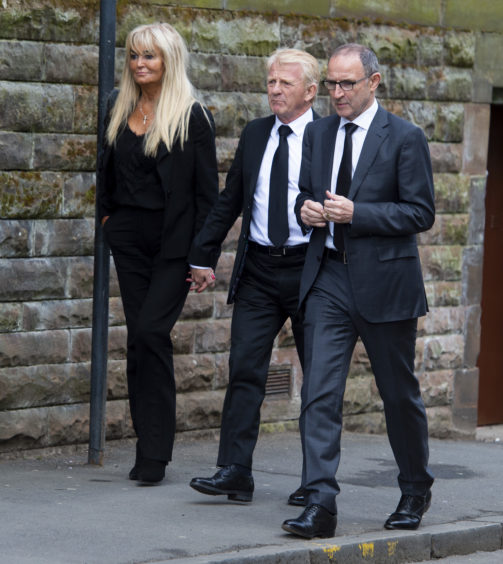 Former Celtic managers Gordon Strachan and Martin O'Neill arrive at the funeral of legendary European Cup winning captain Billy McNeill with Gordon's wife ,Lesley