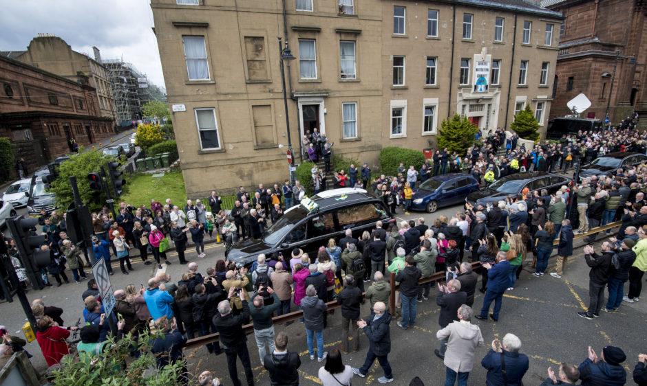 The hearse of Celtic's legendary captain Billy McNeill leaves St Aloysius, following his funeral
