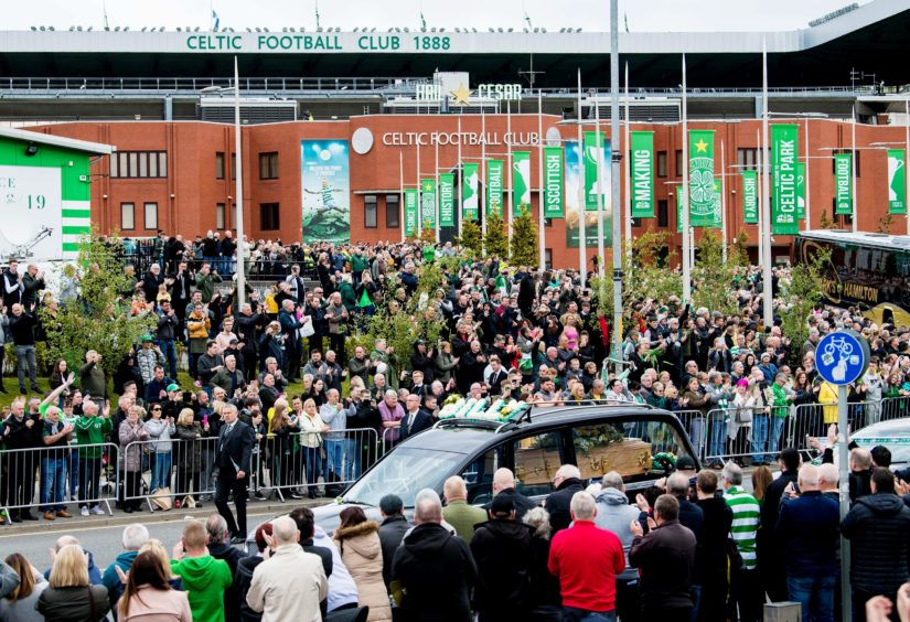 03/05/19 CELTIC PARK - GLASGOW Fans pay their final respects as the hearse of Celtic's legendary captain Billy McNeill makes its way past Celtic Park, following his funeral