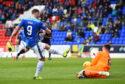 St Johnstone striker Chris Kane is denied a goal.