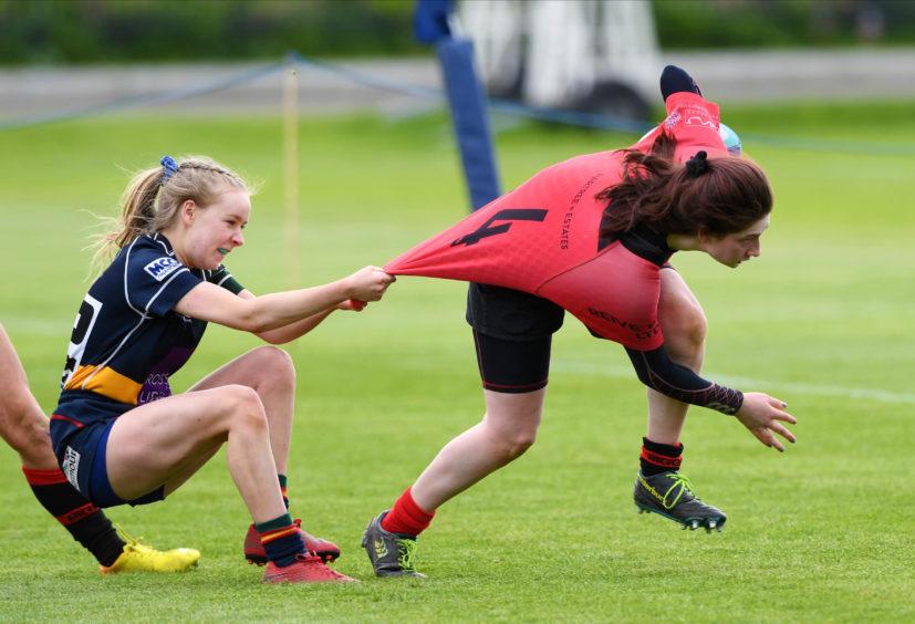 GIRLS CLUB U18 SHIELD FINAL HILLHEAD JORDANHILL v BIGGAR BT MURRAYFIELD - EDINBURGH Hills' Brogan Carberry drags Abigail Clarke down