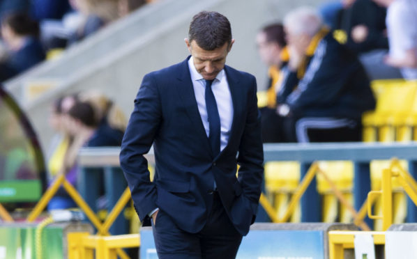 Jim McIntyre has been sacked as Dundee boss.