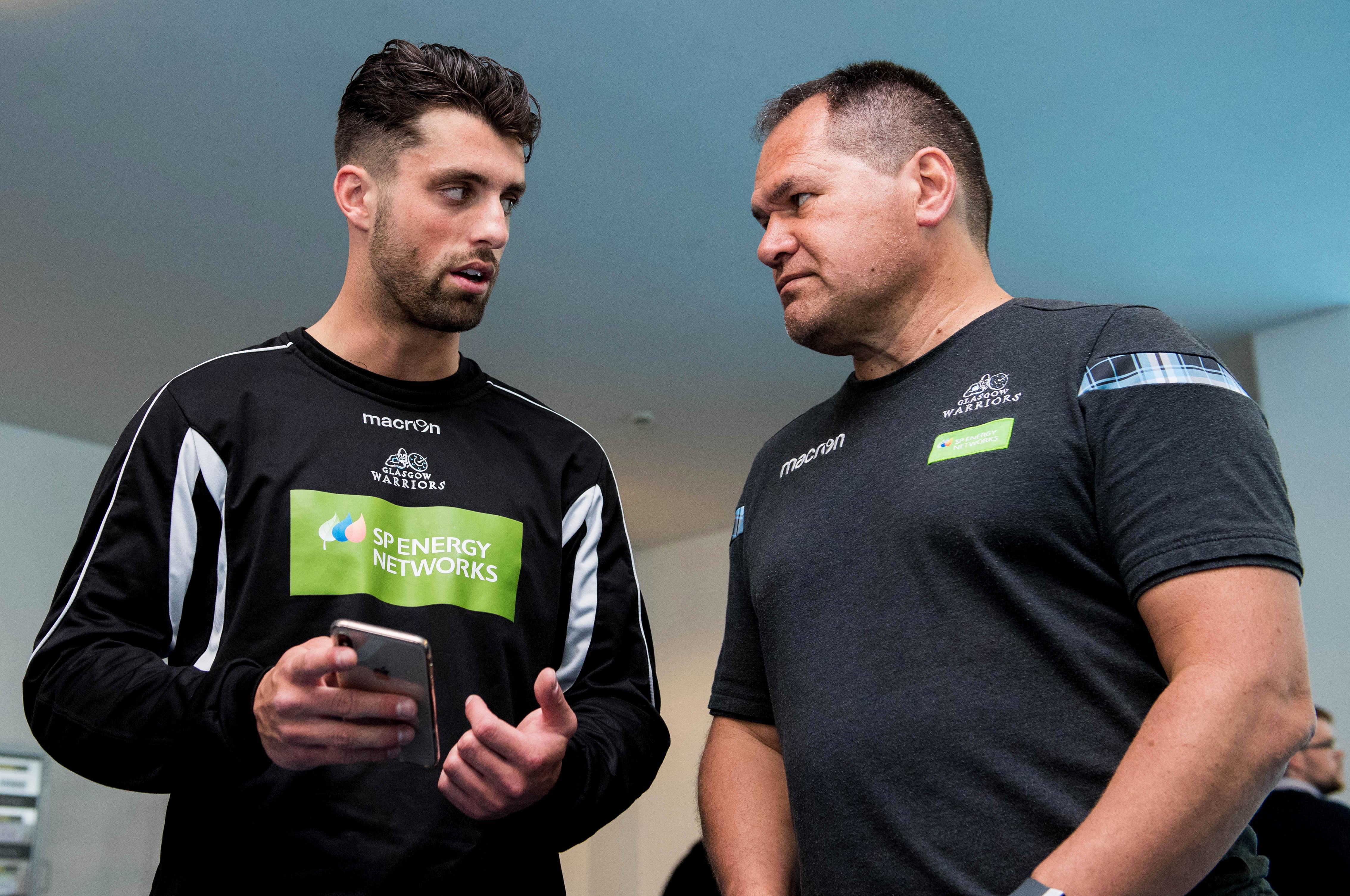 Glasgow Warriors head coach Dave Rennie (R) speaks with Adam Hastings.