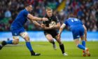 Kyle Steyn takes on Leinster's Jack Conan (left) and Garry Ringrose.