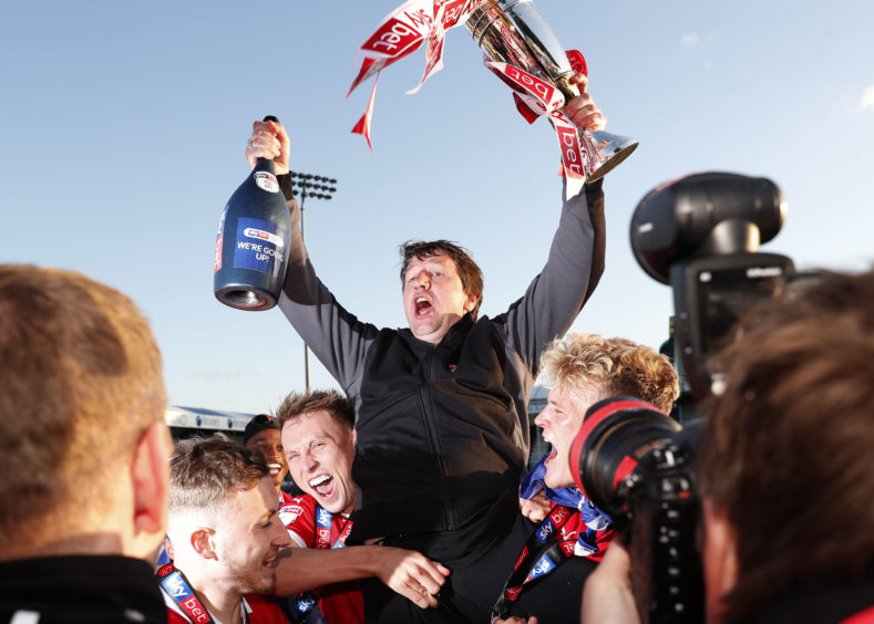 Barnsley's manager Daniel Stendel celebrates promotion after the Sky Bet League One match against Bristol Rovers at Memorial Stadium, Bristol