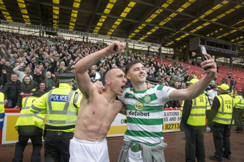 Celtic's Scott Brown and Kieran Tierney celebrate after th final whistle during the Ladbrokes Scottish Premiership match at Pittodrie Stadium, Aberdeen.
