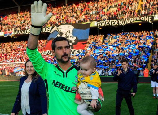 Crystal Palace goalkeeper Julian Speroni walks out for his testimonial match against Dundee at Selhurst Park.