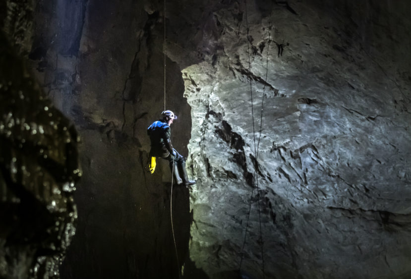 A potholer abseils into Gaping Gill, the largest cavern in Britain, situated in Yorkshire Dales National Park, ahead of its opening the public next weekend.