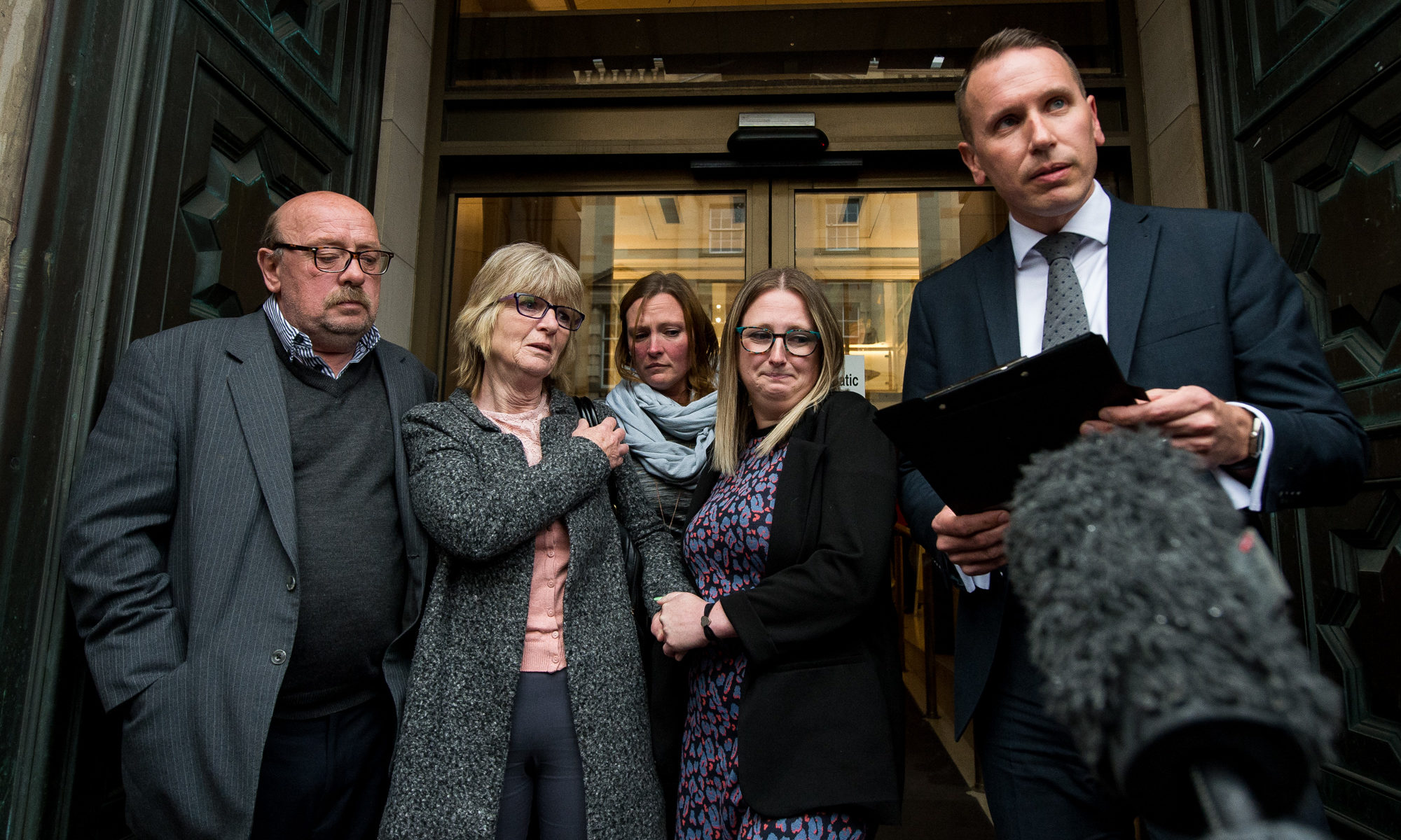 Bill and Pamela Donaldson with their daughters Nicola Yarnell and Lori Robertson, after the verdict, as DCI Andy Patrick reads out a statement on their behalf.