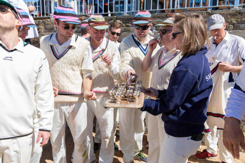 Cricket players from the Ship Inn and Borderers teams hold the first match of the season at the beach on May 12, 2019 in Elie, Scotland. The Ship Inn pub is the only cricket team in the United Kingdom to play their matches on a beach. Over the course of a season they hold regular fixtures against Scottish clubs as well as touring teams from across the world.