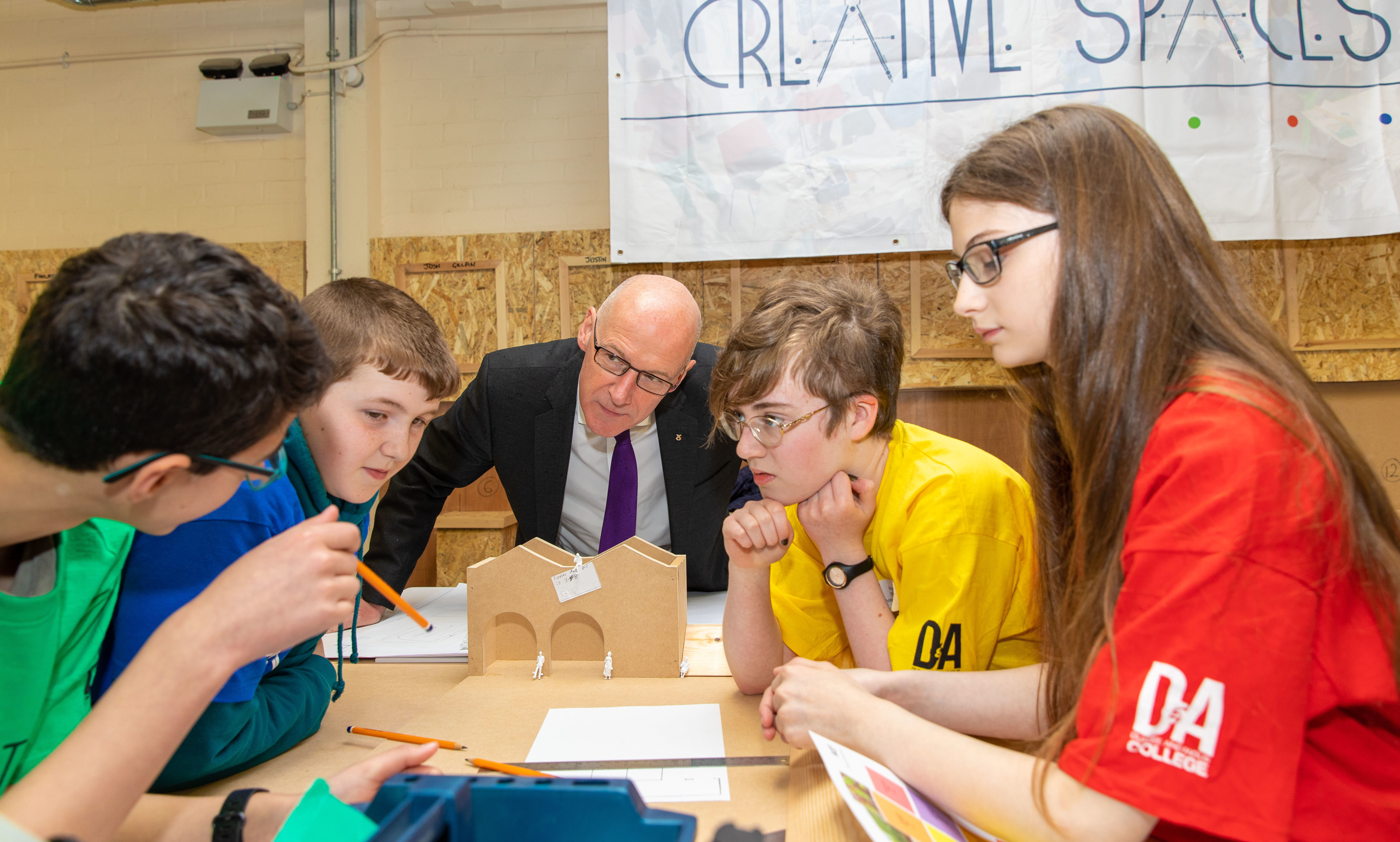 MSP John Swinney speaks to pupils Sven Thomson, Jack Smith, Amy Kelly and Fern Semple from Anderson High School.
