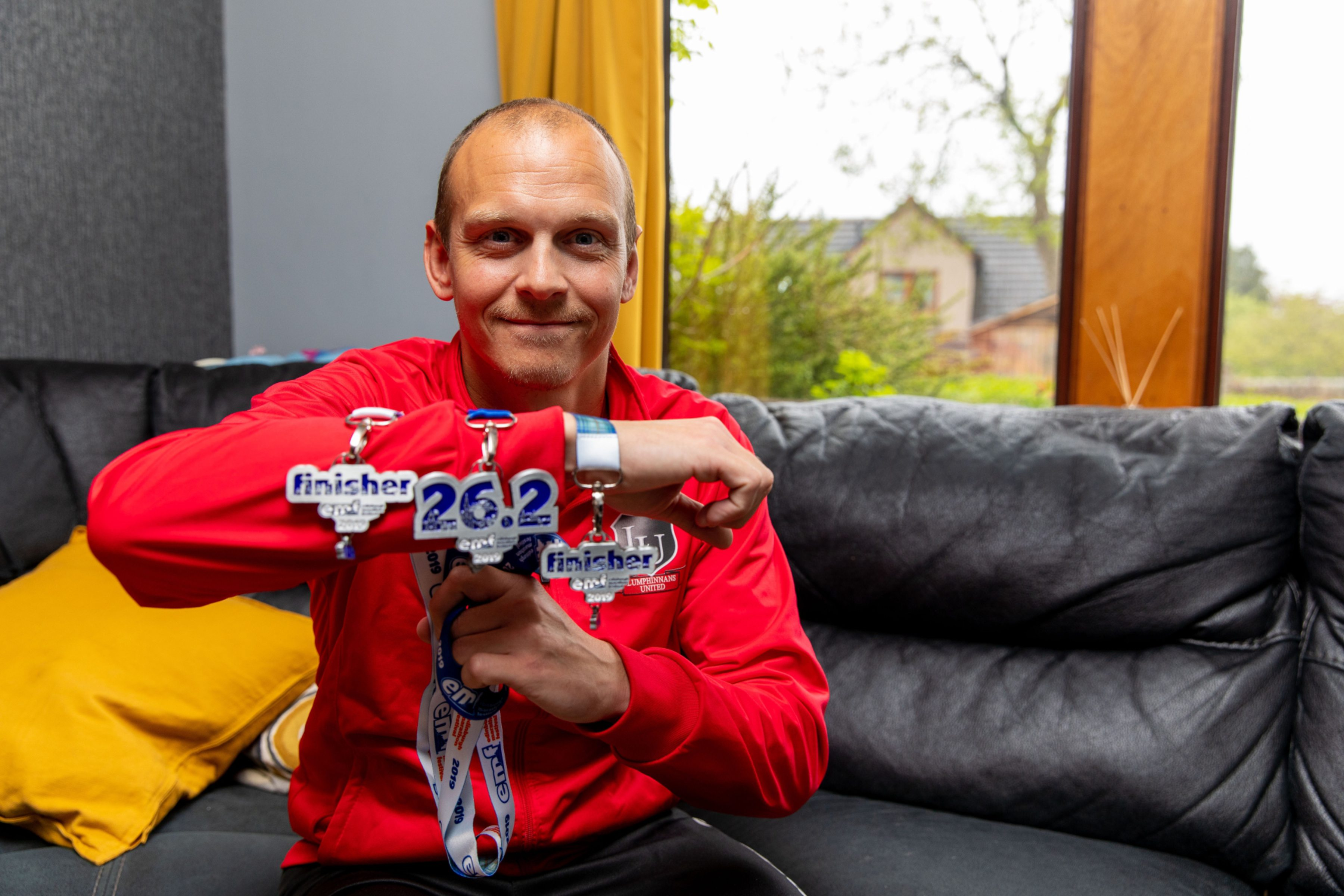 Mike with his medals.