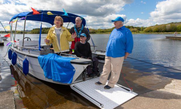 MSP Annabel Ewing, Jim Galloway, Ian Cameron and Merrick Yates, unveil the name of the new Sailability Boat 'Merri-Mac'.