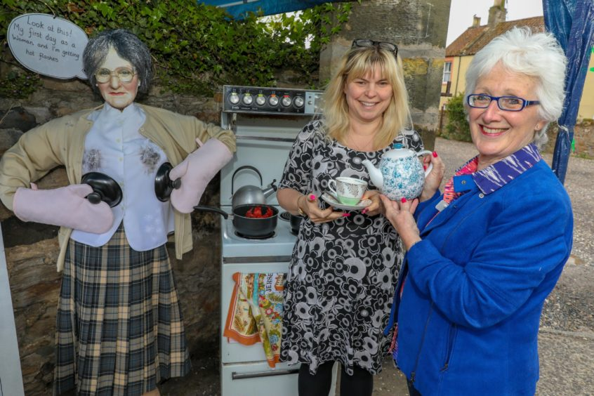 Karen Bell and Janice Lauritsen have a cup of tea with Mrs Doubtfire at Earlsferry House Care Home.