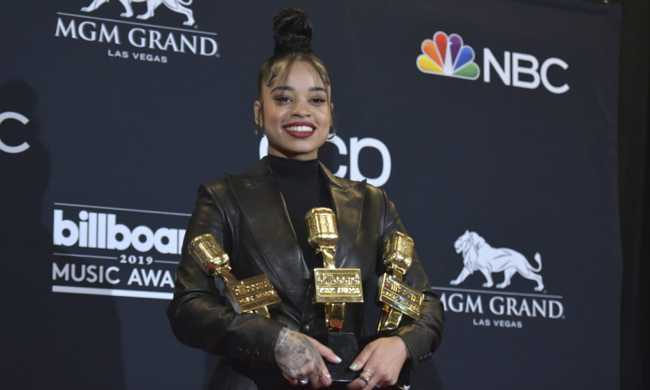 "Ella Mae poses in the press room with her award for top R&B artist, top R&B female artist and top R&B song for ""Boo'd Up"" at the Billboard Music Awards."