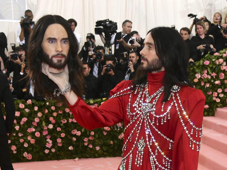 """Jared Leto, holding a model of his own head, attends The Metropolitan Museum of Art's Costume Institute benefit gala celebrating the opening of the """"Camp: Notes on Fashion"""" exhibition on Monday, May 6, 2019, in New York."""
